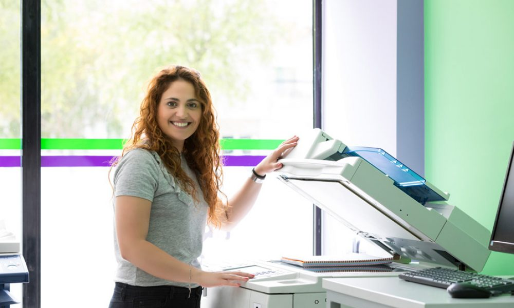 woman-at-copier-green-bg